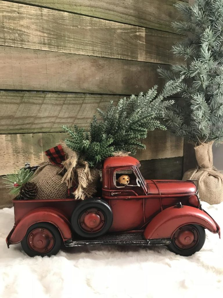 Vintage Holiday Decor With The Classic Red Truck And Christmas Tree